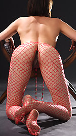 New model Enni with her hard nipples gets friendly with red nets and a chair in this indoor shoot.