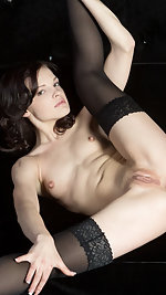 Vikki Mauri, wearing a pair of black lingerie stockings and showcasing her delectable pussy.